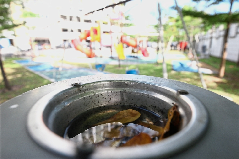 This ash tray on a rubbish bin at a children's playground within the compound of Damai Apartments is an ideal breeding site for mosquitoes.