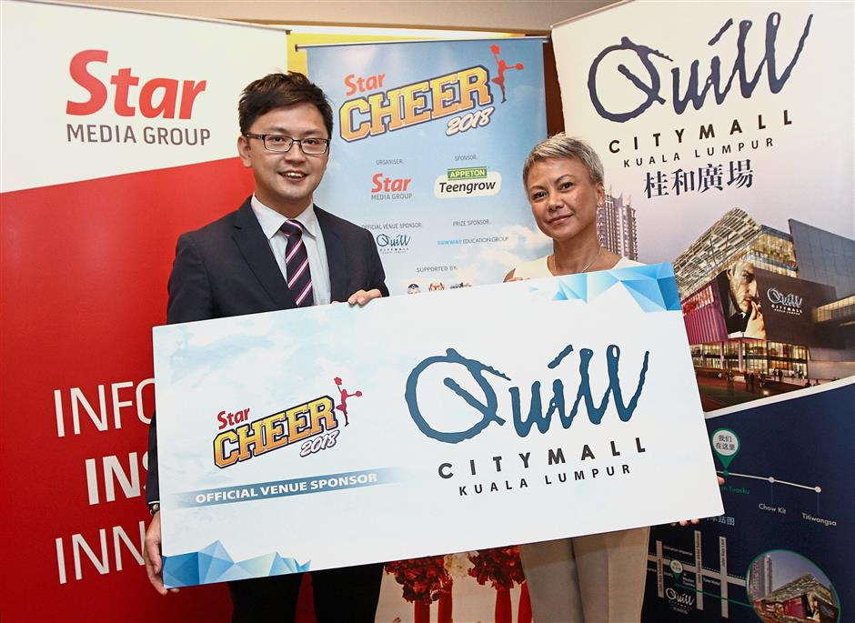 Teo (left) with Star Media Group Bhd advertising and business development manager Mardzlina Ismail.