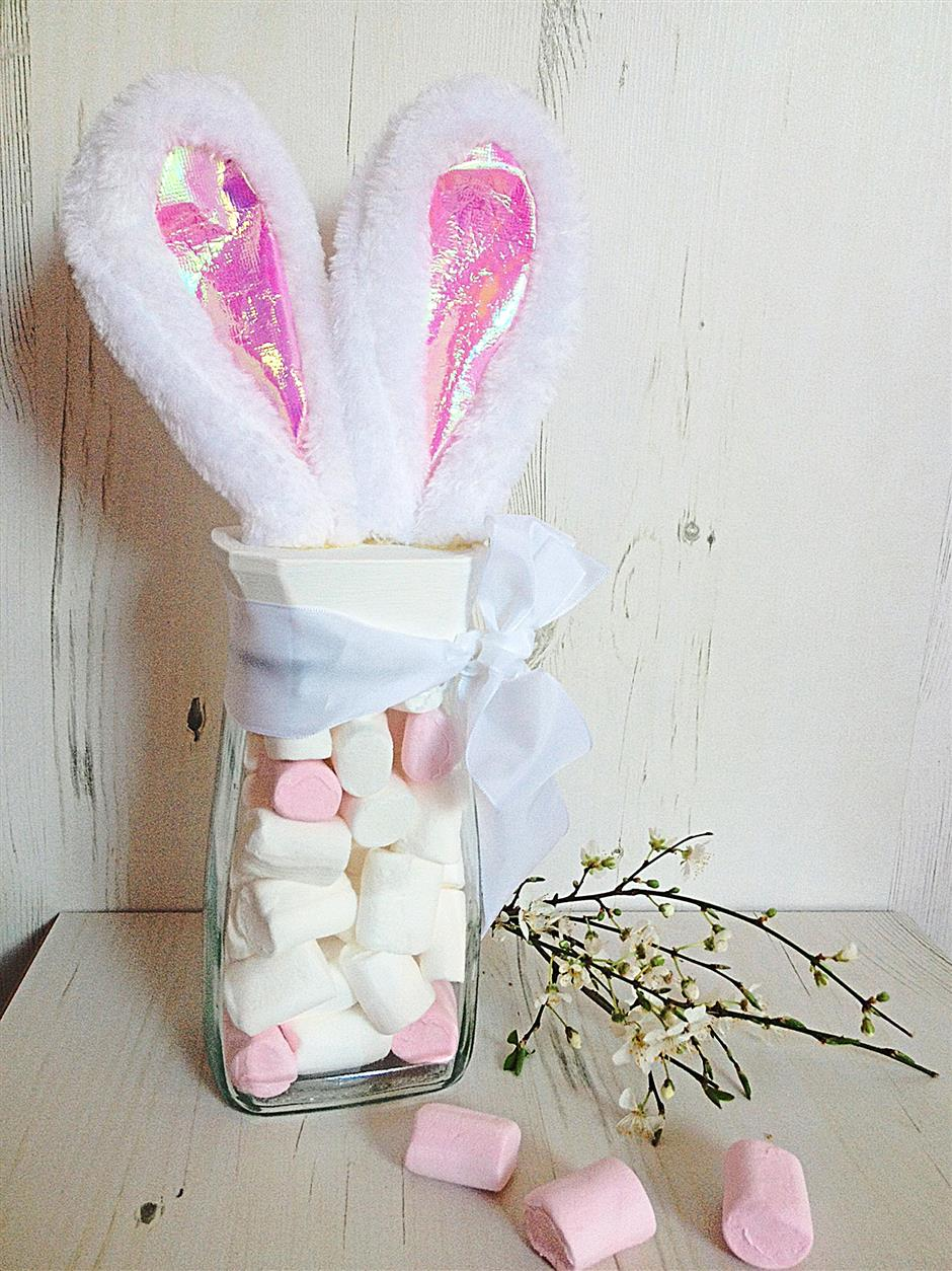 Store your Easter goodies in a sweet bunny-eared jar as designed by Elizabeth Burton of Missielizzie-meandmyshadow.blogspot.co.uk -¿¿ pluck off the ears from a bunny ears headband and add a pom pom for the tail.