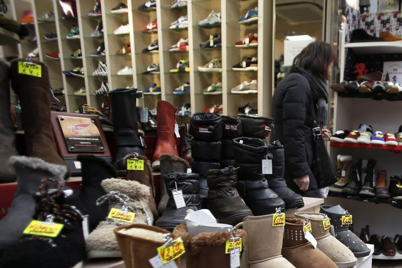 A woman shops for shoes at a shopping arcade in Tokyo on Jan 21, 2014. A Reuters poll of 26 economists forecast Japan\'s economy to have grown 0.7% in the October-December period from the previous quarter - EPA Photo.