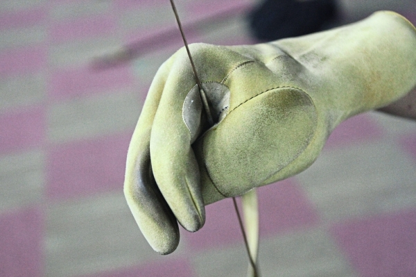 A glove protecting the hand that pulls the bowstring.
