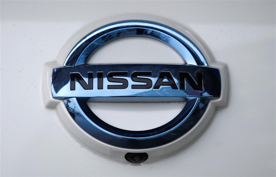 FILE PHOTO: The Nissan company logo is seen on a modified Nissan Leaf, driverless car, during its first demonstration on public roads in Europe, in London, Britain February 27, 2017. REUTERS/Peter Nicholls/File Photo