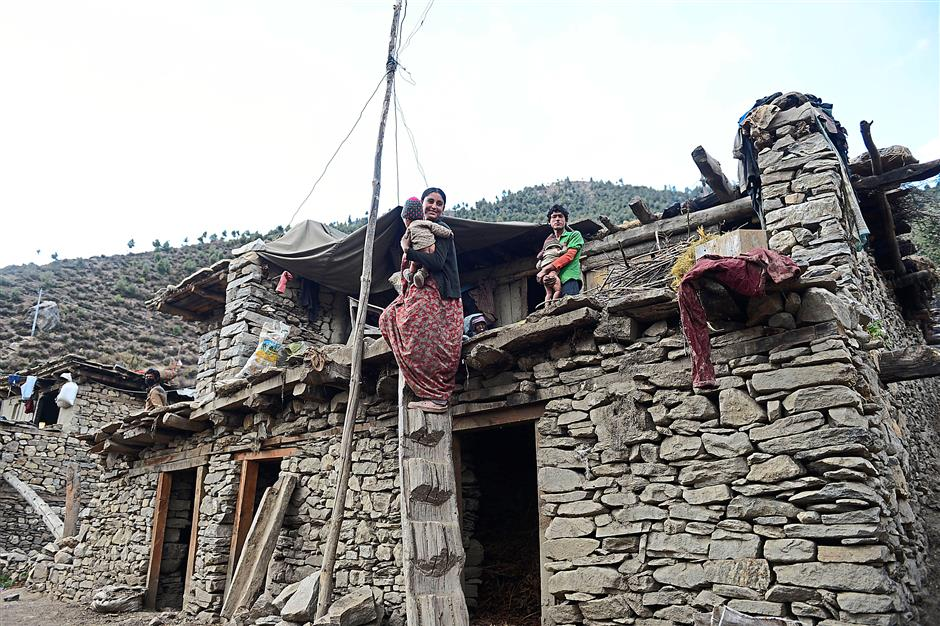 A hard life: Sunar's house on the top floor is basic and she constantly worries about managing the household with her husband's meagre income. - AFP