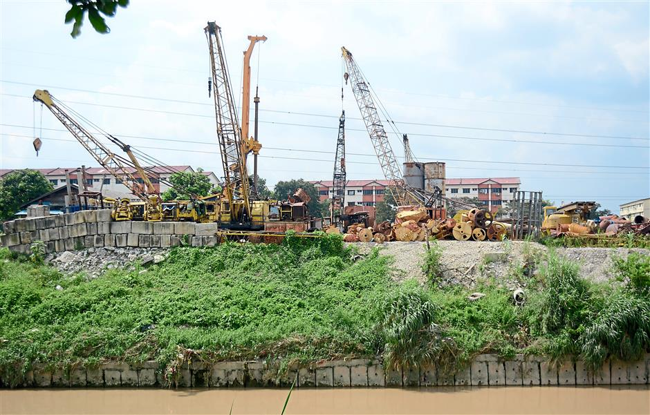 Questionable: An area next to Sungai Kelang along PJS3 that is used to store construction equipment and materials. Haniza urged the land office to investigate its validity.