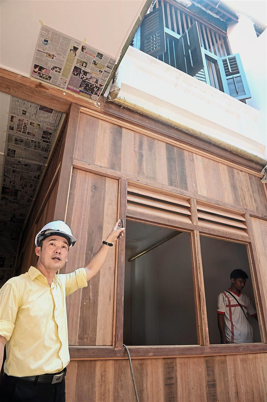Penang Island City Council (MBPP) mayor Yew Tung Seang explaining about the restoration work at six (MBPP) shophouses in Kimberly Street, George Town, Penang.