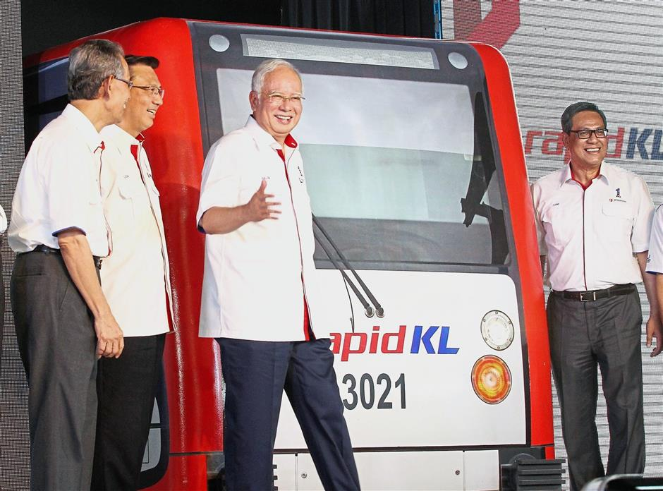 Right on track: 'We are seeing big developments in Malaysia's transportation system: rail, sea and air,' says Liow (second from left), seen here with Prime Minister Datuk Seri Najib Tun Razak at the launch of the Kelana Jaya and Ampang LRT Line Extension project at the Putra Heights LRT station in June 2016.
