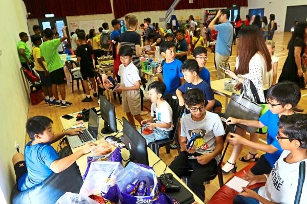 Students enjoying themselves at the PlayStation4 and Nintendo games centre during GEMS Charity Carnival 2019 at GEMS International School at Bandar Tasek Mutiara in Simpang Ampat, Penang. — Photos: ZAINUDIN AHAD/The Star
