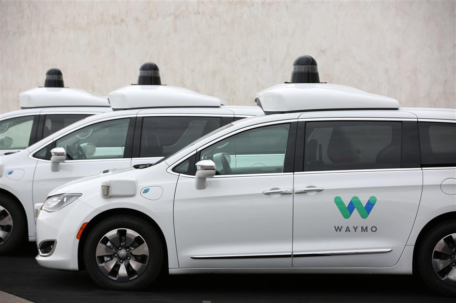 Three of the fleet of 600 Waymo Chrysler Pacifica Hybrid self-driving vehicles are parked and displayed during a demonstration in Chandler, Arizona, November 29, 2018. Picture taken November 29, 2018. REUTERS/Caitlin Ou2019Hara