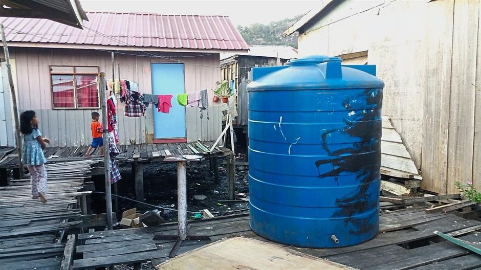 Poor system: Rain water is collected for daily use at an informal settlement in Sandakan where access to water and sanitation is lacking. u2013 Courtesy of Leo Heller