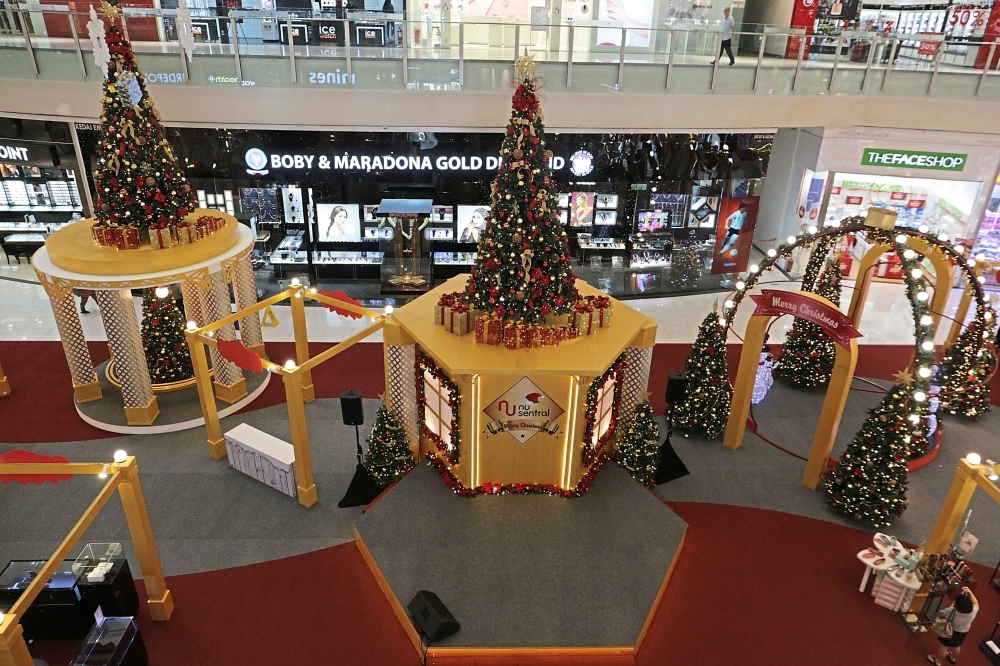 Glass houses with Christmas trees at Nu Sentral Shopping Centre.