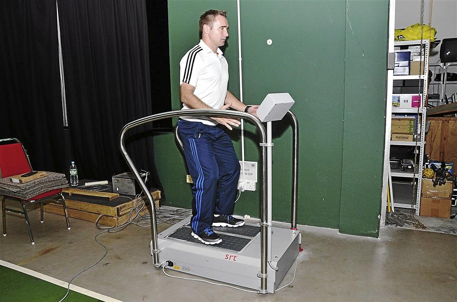 On track to recovery: Football Association of Malaysia (FAM) conditioning trainer Rasto Bozik demonstrates how athletes would stand on the machine during rehabilitation.