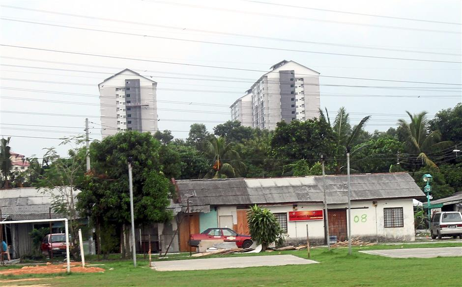 Bye-bye soon: The longhouse near Kampung Baru Jinjang Utara, most of which are in deplorable condition, will soon be a thing of the past after a 20-year wait.