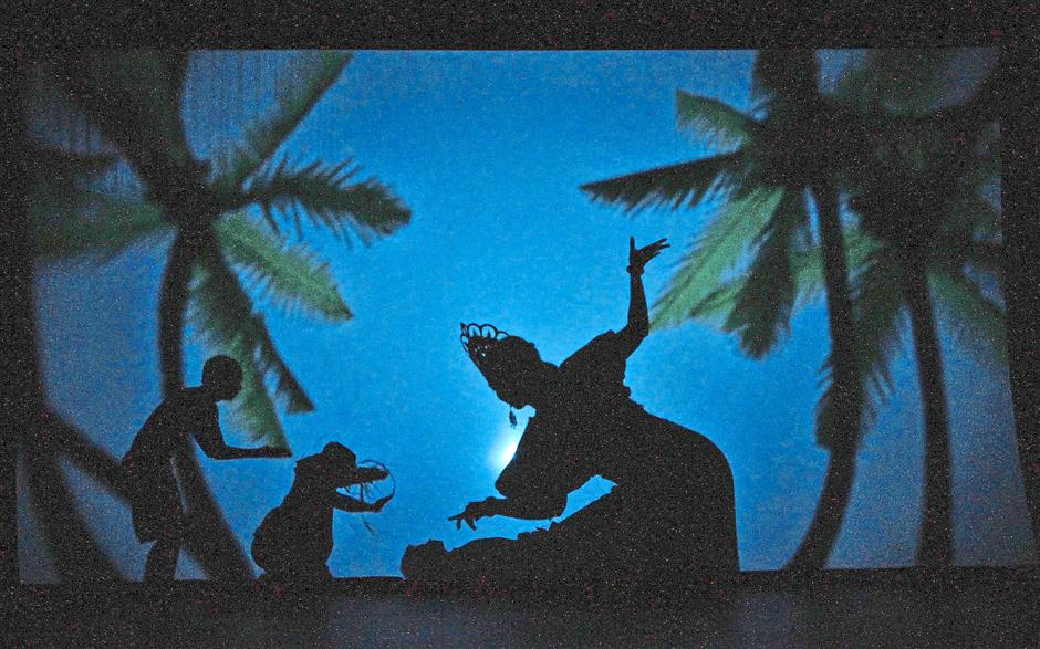 Shadow magic: A scene from Ulek Mayang showing a spirit of the ocean working to restore the soul of a fisherman. Wayang u2013 Malaysian Stories combines shadow puppetry and shadow acting with light works. u2014 CHAN TAK KONG/The Star