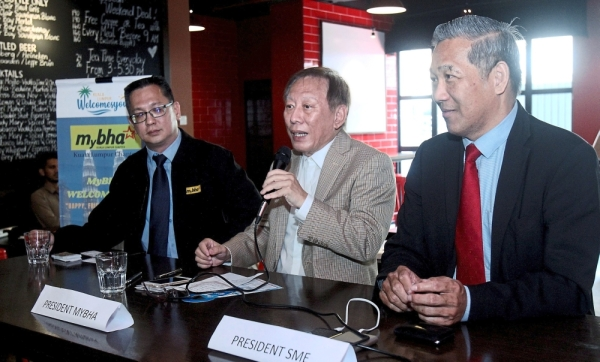 (From left) Oh, Leong and Kang are urging unlicensed budget hotel operators to come forward.