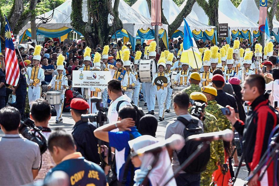 A band from SMJK Chung Hwa Confucian performing at the state-level Merdeka Parade 2018 in Light Street. — Photos: GARY CHEN/The Star