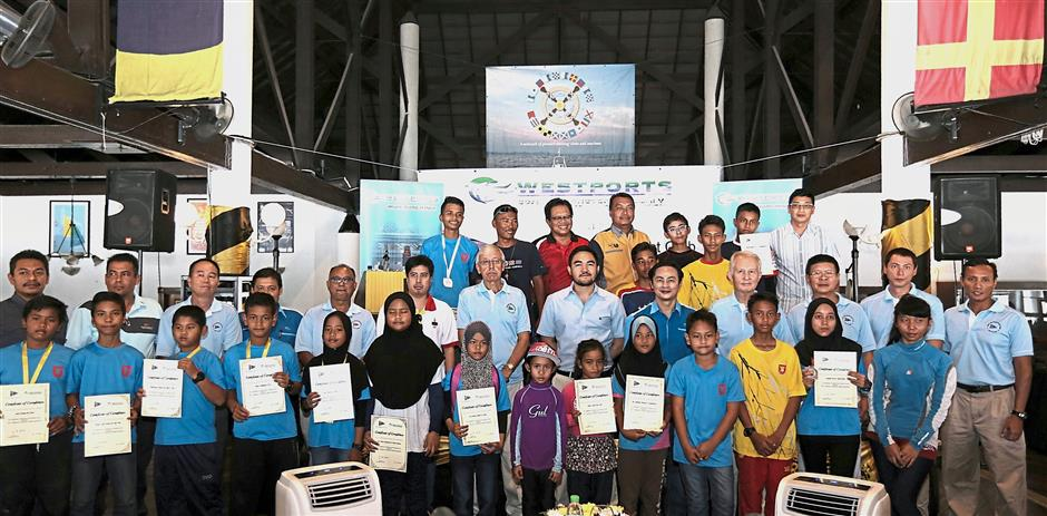 Tengku Amir (second row, sixth from right) with the 13 students who received their certificates after completing their 2017 training at the launch of this years programme.