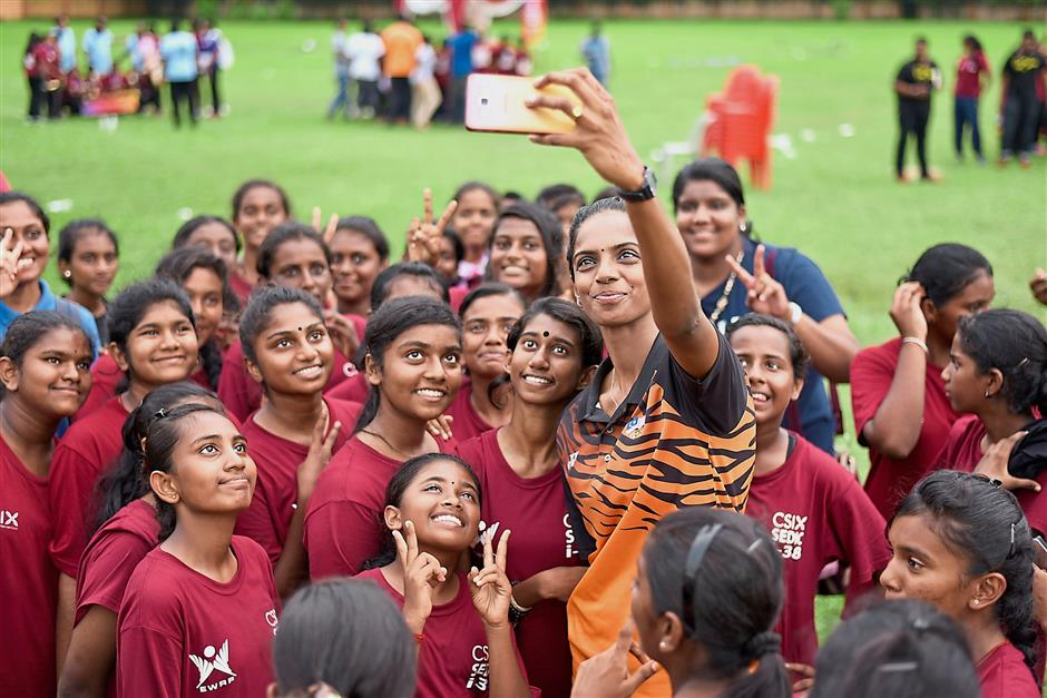 National netball player K. Shandraleka swamped by students after finishing a netball tournament organised by Educational Welfare and Research Foundation (EWRF Malaysia) as part of its Civil Society Intervention programme for 'at-risk' youths.