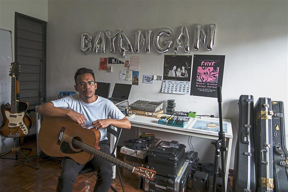 Fikri, who goes by the stage name Bayangan, in his home studio in TTDI. He doesn't expect streaming services to fund any of his music efforts. — Bayangan.