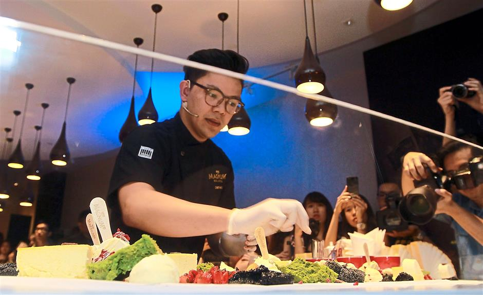 Creating happiness: Aspiras making desserts for the crowd at the grand opening of Magnum Kuala Lumpur.