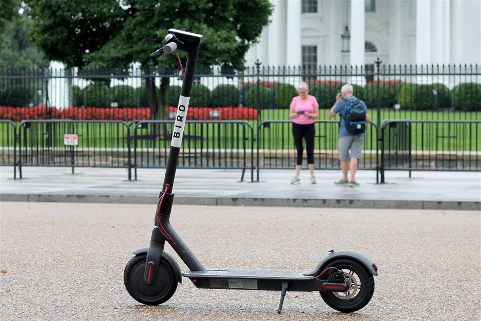 A rentable electric scooter from Bird pictured on a pavement in Washington. Photo: Magdalena Troendle/dpa