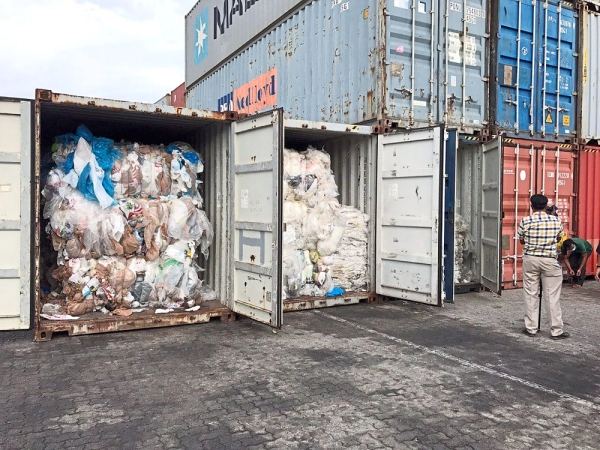 In this Tuesday, July 16, 2019, photo, containers loaded with plastic waste are placed at country beach city, Sihanoukville Port, southwest of Phnom Penh, Cambodia. A Cambodia\'s committee to investigate the sources of the trash discovered packing in more than 80 containers at country beach city, Sihanoukville Port, is needing seven to ten days to conclude their investigative, an official said Wednesday, July 17, 2019. (AP Photo/Sea Seakleng)