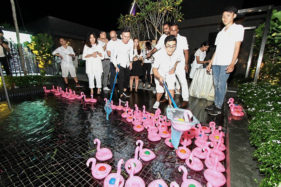 Guests playing the Flamingo Catch game during the topping out ceremony of the Tri Pinnacle in Tanjung Tokong, Penang. — Photos: CHAN BOON KAI/The Star