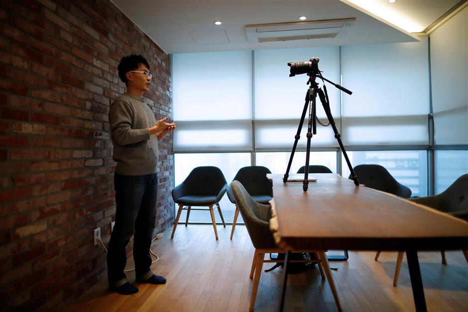 Yoon Chang-hyun works on his Youtube clip in Seongnam, South Korea, February 12, 2019. Picture taken February 12, 2019. REUTERS/Kim Hong-Ji