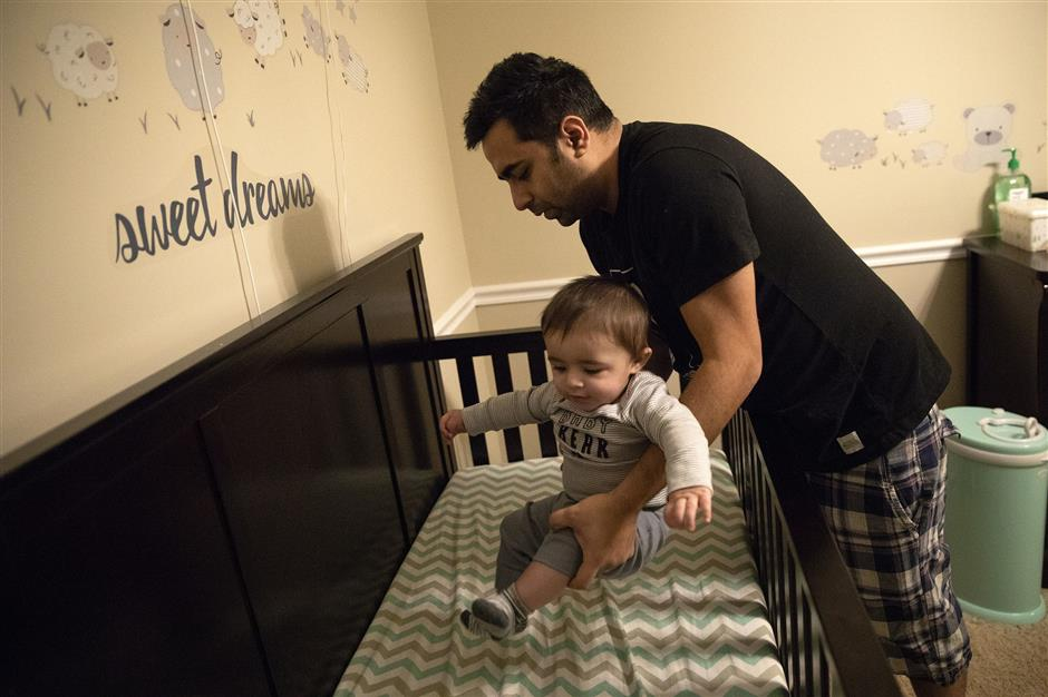 Arjun Sud puts his 7-month-old son Oliver down for a nap in Lake Barrington. On Jan. 20, Sud heard a man's voice coming from the Nest camera mounted about his son's crib. The next cameras and thermostat in the Sud family's home had been hacked. (Erin Hooley/Chicago Tribune/TNS)
