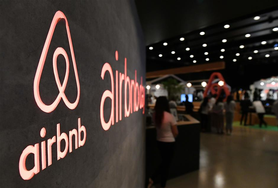 (FILES) In this file photo taken on June 14, 2018 the US rental site Airbnb logo is displayed during the company's press conference in Tokyo. A decade ago a pair of San Francisco roommates decided to make rent money by using air mattresses to turn their place into a bed-and-breakfast when a conference in the city made hotel rooms scarce. The brainwave led to the creation of Airbnb, a startup now valued at more than $30 billion which boasts millions of places to stay in more than 191 countries, from apartments and villas to castles and treehouses.  / AFP PHOTO / Toshifumi KITAMURA