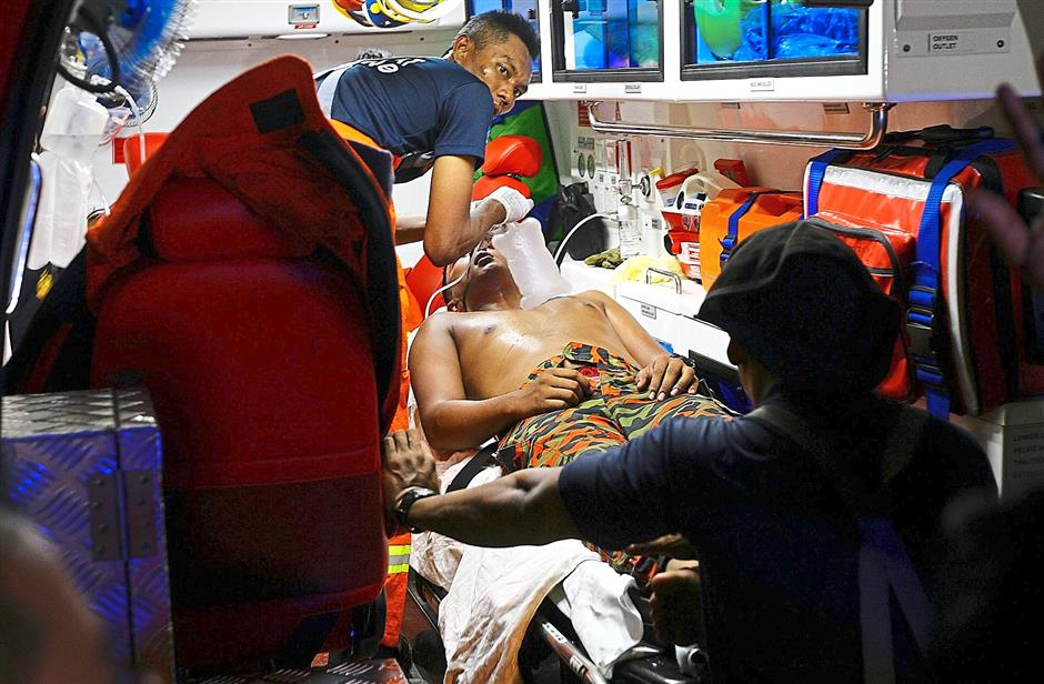 1 One of the Fire and Rescue Department personnel injured during putting out the fire at the recycle rubber factory in Juru Height,Penang. Star pic by: ZHAFARAN NASIB/The Star/ 24 June 2015.