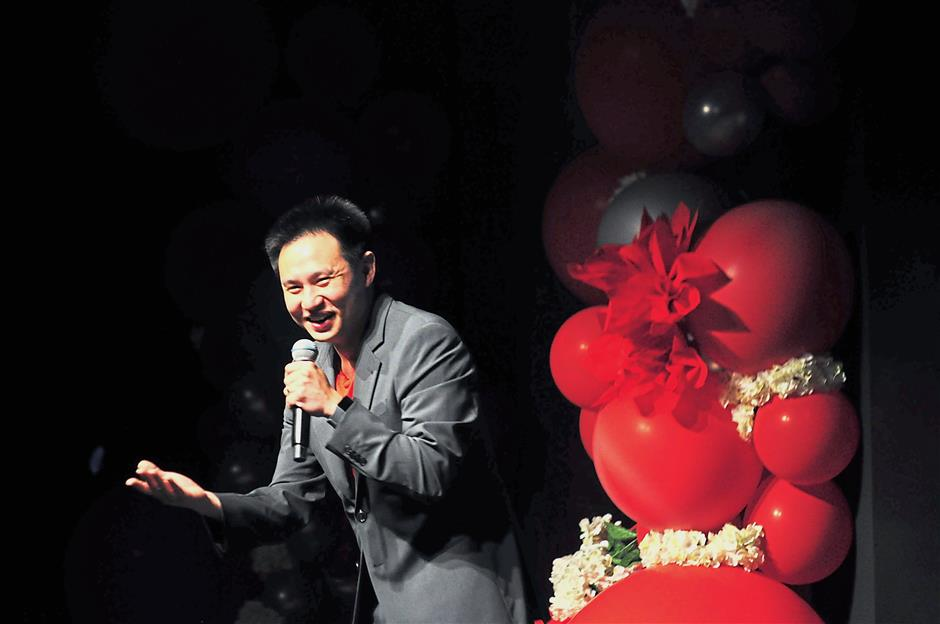 Comedian Douglas Lim cracking jokes at the event.