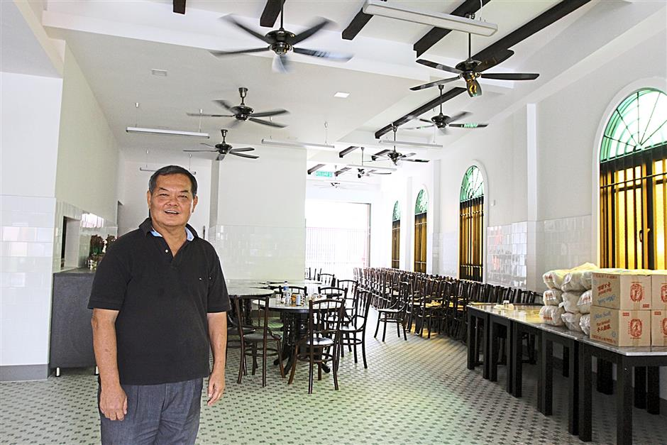 Jack Lee Kwong Hon, 70, standing in the new Yut Kee kept in the old world charm.