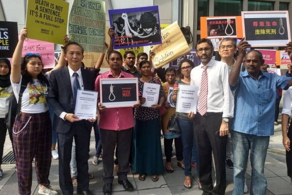 Family members of the death row inmates and civil society organisatio members gathered in front of the Singapore High Commission on July 25, 2019.