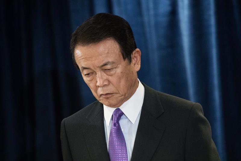 Finance Minister Taro Aso says the yen has fallen rapidly, considering the dollar was around 79 yen when the Abe administration took over in December 2012 to above 115 yen this month - AFP Photo.