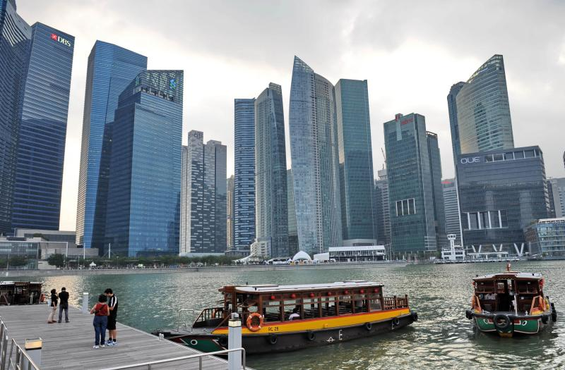 This photograph taken on March 3, 2014 shows the financial district in Singapore. Singapore\'s economic growth slowed sharply in the first three months of the year, data showed on April 14, but the central bank stood pat on monetary policy saying it would be lifted by a pick-up in global growth - AFP Photo.