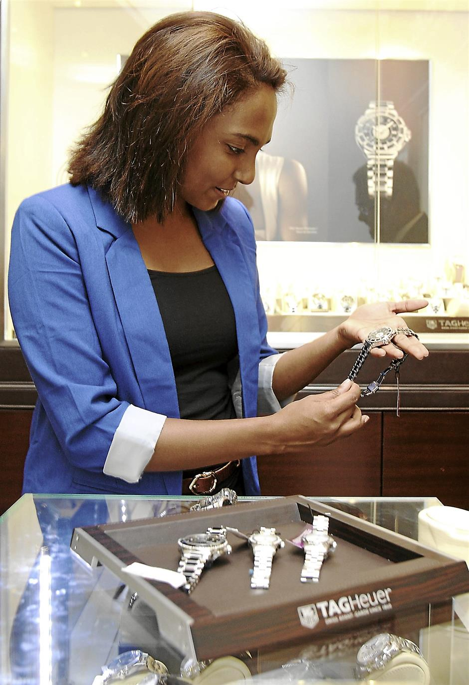 Picking out a timepiece as a gift for her father from luxury watch boutique Swiss Watch Gallery.