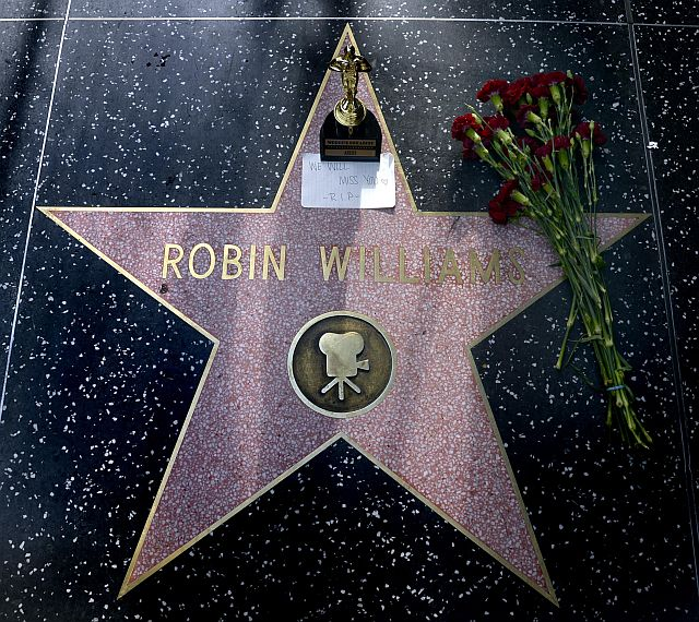 Flowers and an Oscar souvenir are placed on the Hollywood Walk of Fame star for US actor Robin Williams in Hollywood, California who died of an apparent suicide in his Tiberon home north of San Francisco, California, USA. -EPA