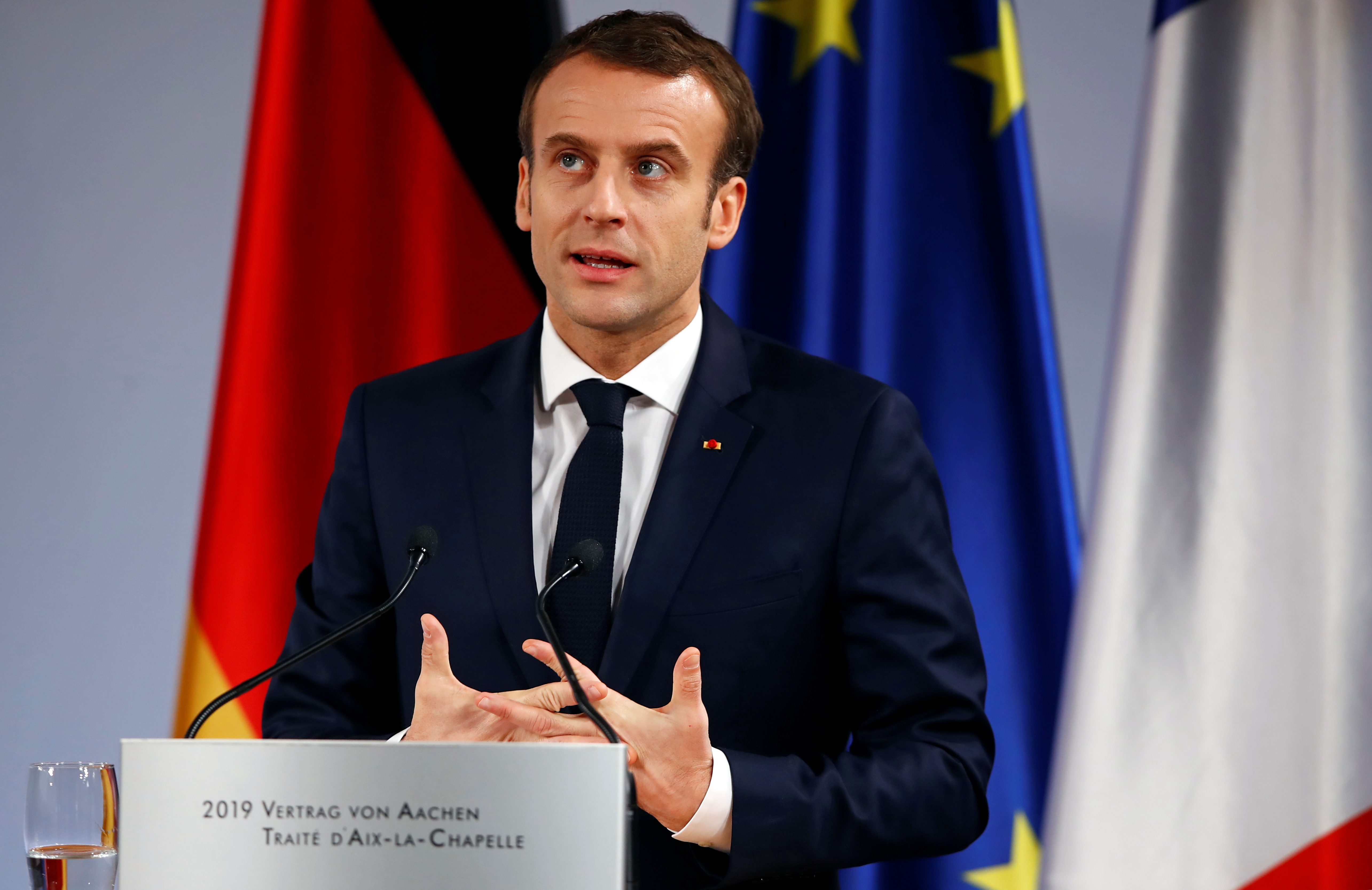 FILE PHOTO: French President Emmanuel Macron speaks during a signing of a new agreement on bilateral cooperation and integration, known as Treaty of Aachen, in Aachen, Germany, January 22, 2019. REUTERS/Wolfgang Rattay/File Photo