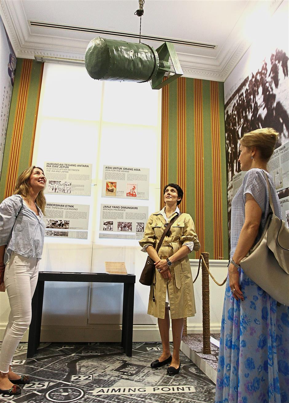 (From left) Masa Pipic Glavac, Tamara Hardikar and Marina Cherkasenko Winzap, from Croatia, Italy and Switzerland, respectively, looking at a replica of a World War II bomb on display at the exhibition.