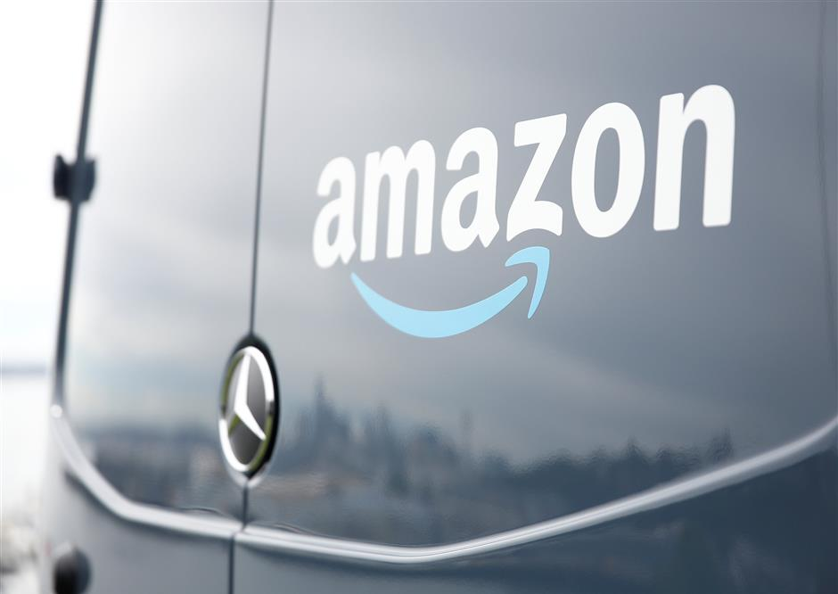 An Amazon Prime van during a press conference announcing Amazon.com\'s new program to help entrepreneurs build businesses delivering Amazon packages, including $1 million to fund startup costs for military veterans, at an event space in Seattle, Washington, U.S., June 27, 2018.  REUTERS/Lindsey Wasson