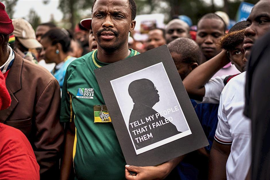 Under pressure: Many South Africans were happy when Zuma announced his immediate resignation in a TV address to the nation after the ruling ANC party threatened to eject him from office via a parliamentary vote of no confidence. — AFP