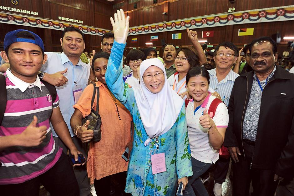 Clear winner: Wan Azizah and some of her supporters posing for a group photo at the tally centre in Bukit Mertajam.