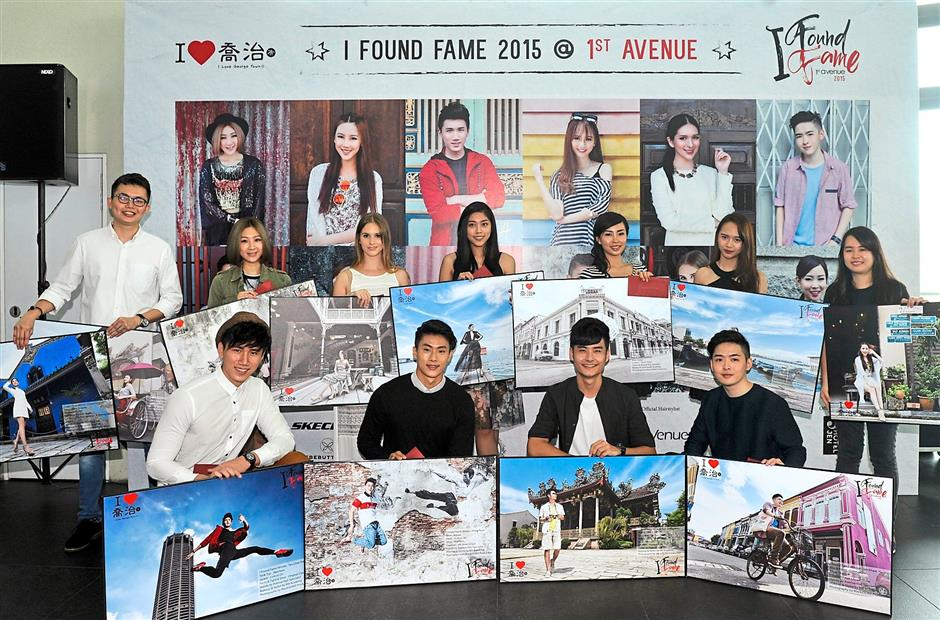 We're so excited: Winners of 1st Avenue Penang's I Found Fame 2015 contest showing off their featured photos. With them is Ooi (last row, left).
