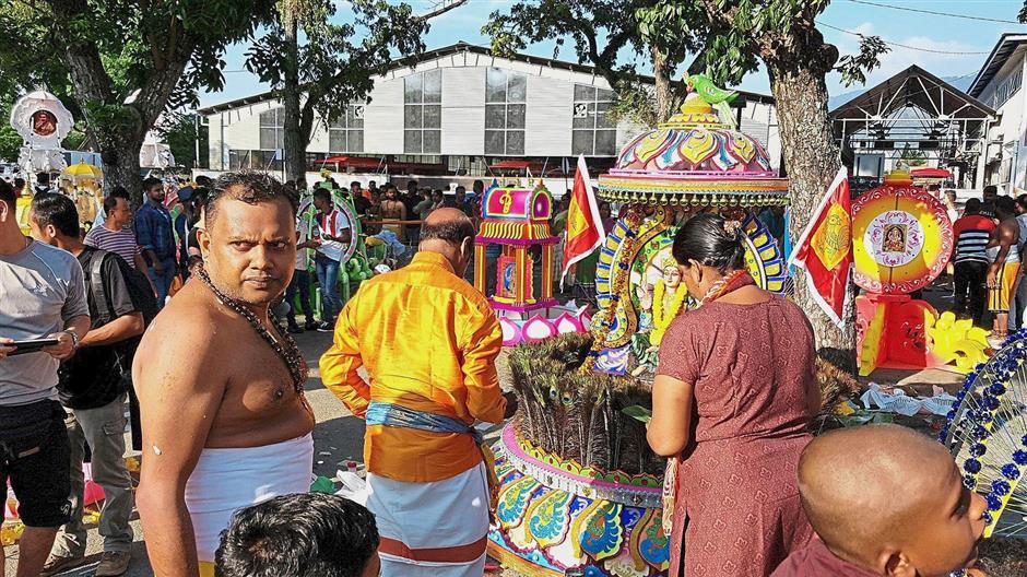 Dr Sarveswara preparing to carry his 45kg kavadi in Lorong Kulit, George Town.