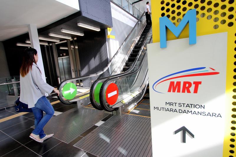 A commuter walking past by the enterance of Mutiara Damansara MRT Station at Mutiara Damansara in Kuala Lumpur. - Filepic