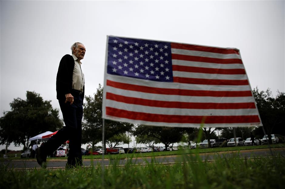 A man arrives at a polling station in Lark Community Center as the early voting for midterm elections started in Texas, in McAllen, Texas, U.S., October 22, 2018. REUTERS/Carlos Barria