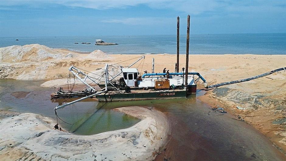 A sand dredge in operation at Pasir Panjang, Segari, Manjung. Environmentalists believe the activity is damaging the delicate ecosystem of one of the few major turtle landing sites in the state.
