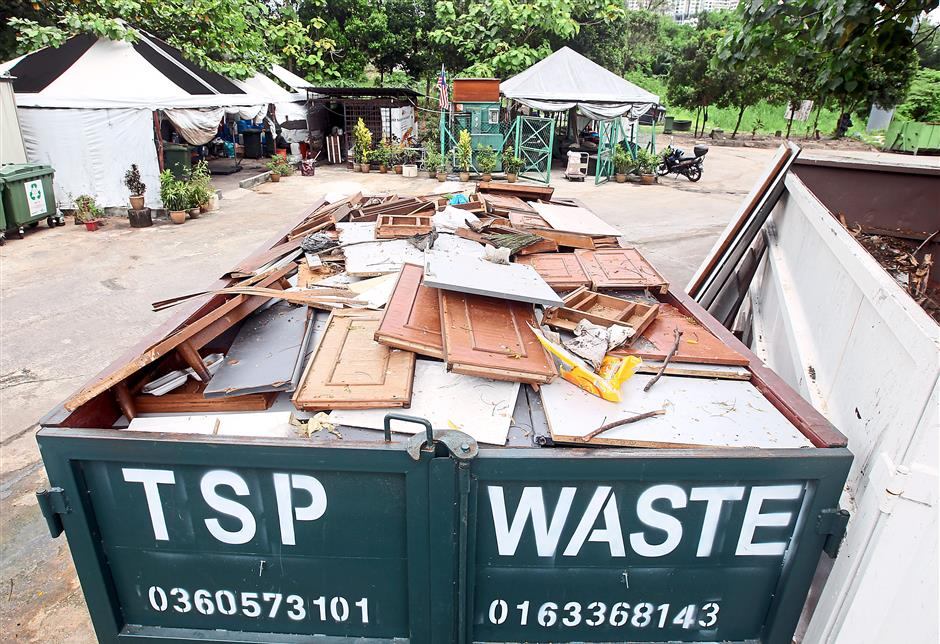 Wood waste consisting of unwanted furniture and tree cuttings are sent to a paper mill for use as fuel. Photo: AZHAR MAHFOF/The Star
