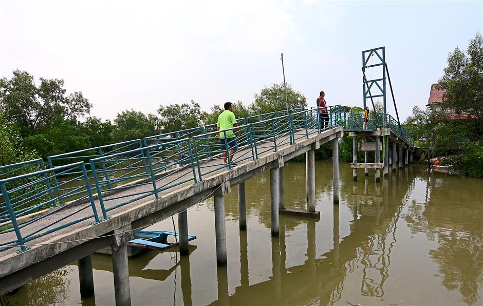 The bridge was previously made of wood until it was remodeled using concrete in 1994. Supported by metal bars and pillars now, Chia said theyre looking to install steel ones instead due to rusting issues.