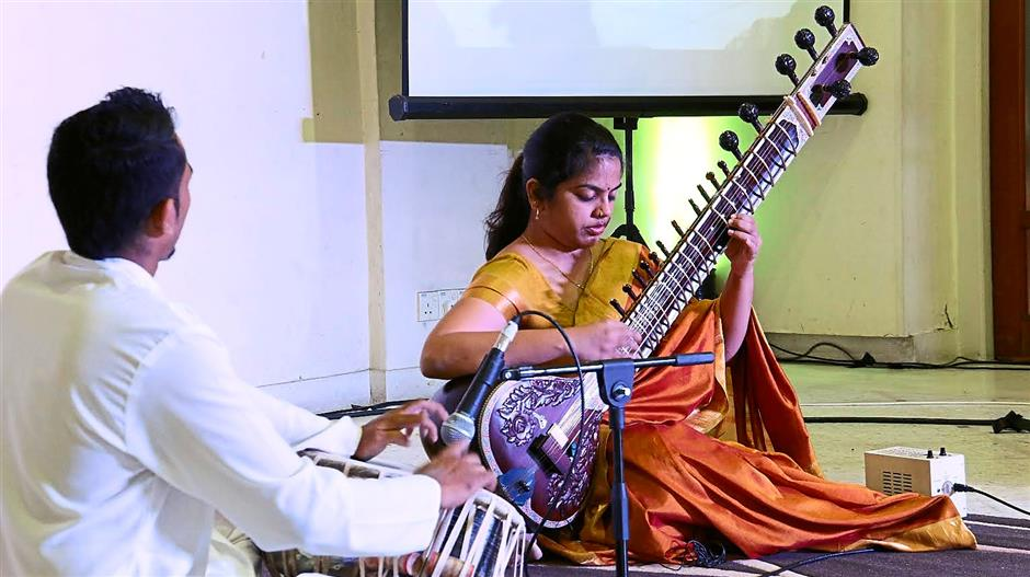 Traditional tunes: Kalpana Paramjothy and Selvendrrah Krishna from the Temple of Fine Arts performing the sitar and tabla.
